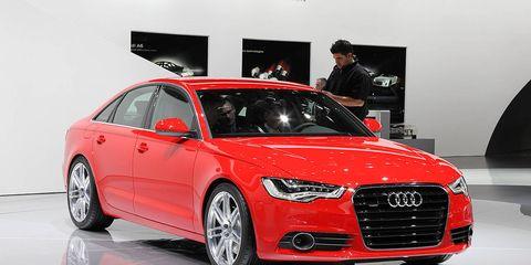 Tire, Automotive design, Vehicle, Event, Alloy wheel, Car, Grille, Personal luxury car, Audi, Luxury vehicle,