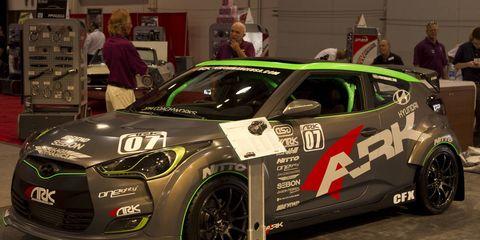 Wheel, Tire, Automotive design, Vehicle, Car, Hatchback, Alloy wheel, Logo, Race car, Auto show,
