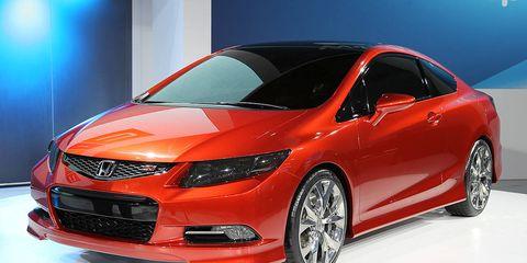 Automotive design, Mode of transport, Vehicle, Event, Car, Automotive lighting, Automotive mirror, Mid-size car, Alloy wheel, Auto show,