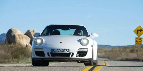 Automotive design, Road, Transport, Car, Asphalt, Road surface, Sports car, Performance car, Bumper, Luxury vehicle,
