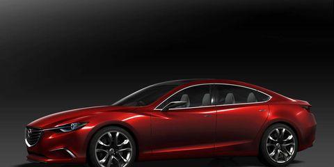 Wheel, Mode of transport, Automotive design, Vehicle, Automotive lighting, Car, Red, Mid-size car, Alloy wheel, Luxury vehicle,