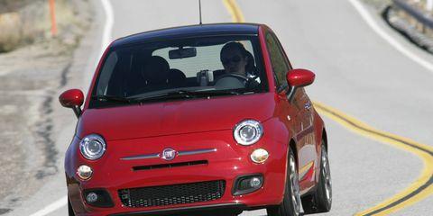 Automotive design, Vehicle, Land vehicle, Road, Car, Red, Asphalt, Hood, Bumper, Automotive mirror,