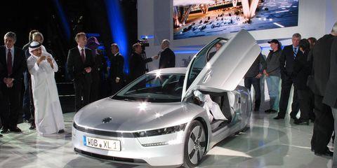 Automotive design, Vehicle, Product, Event, Land vehicle, Car, Auto show, Exhibition, Luxury vehicle, Personal luxury car,