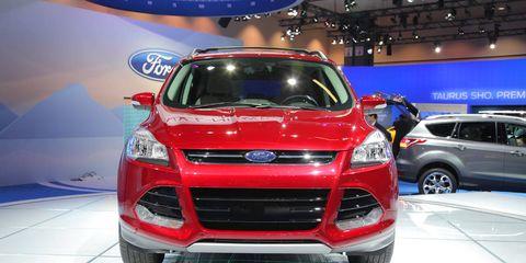 Automotive design, Vehicle, Land vehicle, Event, Car, Grille, Automotive lighting, Exhibition, Auto show, Headlamp,