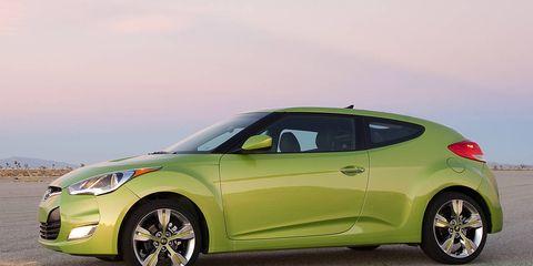 Tire, Motor vehicle, Wheel, Mode of transport, Automotive design, Vehicle, Land vehicle, Car, Glass, Vehicle door,