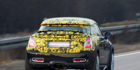 Tire, Automotive design, Road, Yellow, Vehicle, Automotive tire, Car, Road surface, Automotive tail & brake light, Automotive lighting,