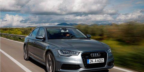 Automotive design, Automotive mirror, Road, Vehicle, Vehicle registration plate, Headlamp, Grille, Automotive exterior, Transport, Car,