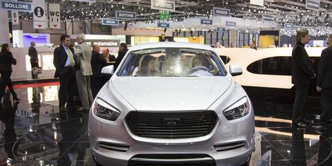 Automotive design, Vehicle, Event, Grille, Headlamp, Car, Personal luxury car, Auto show, Mid-size car, Luxury vehicle,