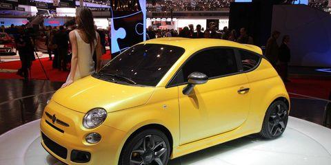 Motor vehicle, Wheel, Automotive design, Vehicle, Yellow, Car, Automotive wheel system, Auto show, Exhibition, Rim,