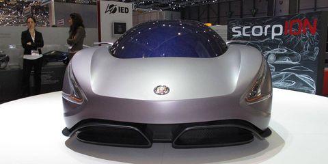 Automotive design, Mode of transport, Vehicle, Car, Supercar, Sports car, Logo, Light, Fashion, Auto show,
