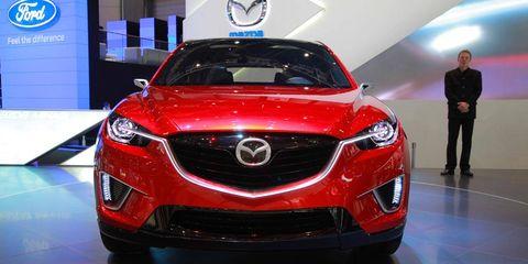 Automotive design, Vehicle, Event, Land vehicle, Car, Grille, Automotive lighting, Auto show, Exhibition, Logo,