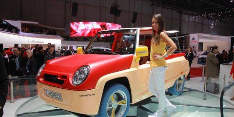 Automotive design, Car, Auto show, Exhibition, Alloy wheel, Logo, Automotive wheel system, Vehicle door, Steering wheel, Auto part,