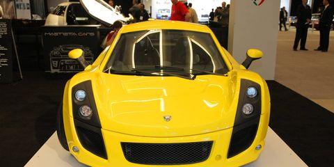 Automotive design, Yellow, Vehicle, Event, Car, Supercar, Performance car, Sports car, Bumper, Headlamp,