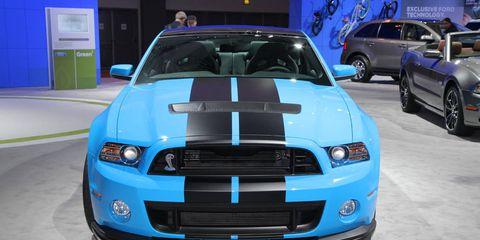 Automotive design, Blue, Vehicle, Hood, Grille, Headlamp, Car, Automotive exterior, Electric blue, Automotive lighting,