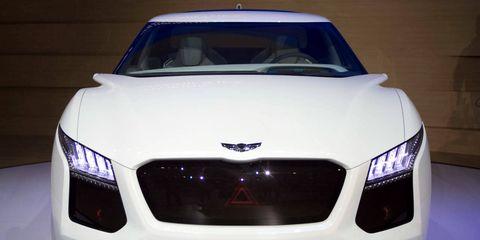 Automotive design, Vehicle, Grille, Automotive exterior, Hood, Car, Personal luxury car, Luxury vehicle, Light, Bumper,