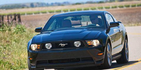 Automotive design, Blue, Daytime, Vehicle, Hood, Headlamp, Automotive lighting, Grille, Car, Fender,