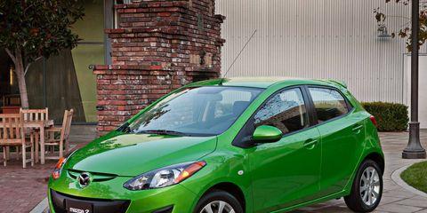 Tire, Motor vehicle, Wheel, Automotive mirror, Mode of transport, Green, Vehicle, Glass, Land vehicle, Headlamp,