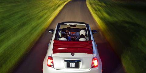 Automotive design, Vehicle, Automotive tail & brake light, Automotive mirror, Car, Road, Automotive exterior, Vehicle door, Automotive lighting, Plain,