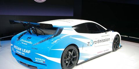 Automotive design, Mode of transport, Vehicle, Car, Fender, Sports car, Automotive exterior, Logo, Auto show, Supercar,