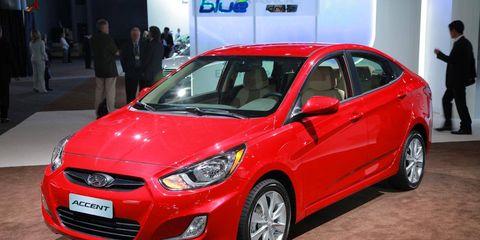 Tire, Wheel, Motor vehicle, Automotive design, Vehicle, Land vehicle, Car, Automotive wheel system, Red, Headlamp,
