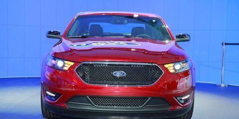 Motor vehicle, Automotive design, Blue, Product, Daytime, Vehicle, Automotive lighting, Land vehicle, Headlamp, Grille,