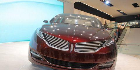 Automotive design, Vehicle, Event, Land vehicle, Grille, Car, Personal luxury car, Automotive lighting, Auto show, Exhibition,
