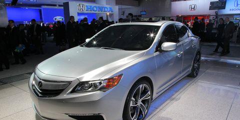 Automotive design, Vehicle, Event, Land vehicle, Car, Glass, Automotive lighting, Personal luxury car, Fender, Mid-size car,