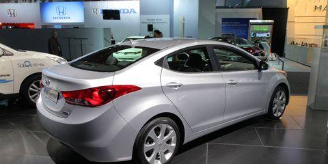 Motor vehicle, Wheel, Tire, Mode of transport, Automotive design, Vehicle, Event, Land vehicle, Car, Floor,