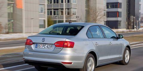 Tire, Wheel, Mode of transport, Automotive design, Vehicle, Vehicle registration plate, Automotive tire, Road, Window, Automotive lighting,