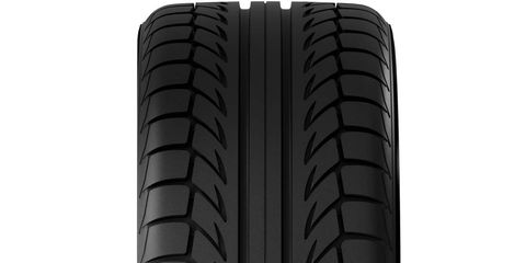 Automotive tire, Synthetic rubber, Tread, Line, Tower block, Black, Parallel, Grey, Carbon, Composite material,