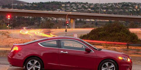 Tire, Wheel, Vehicle, Car, Alloy wheel, Performance car, Rim, Red, Fender, Luxury vehicle,