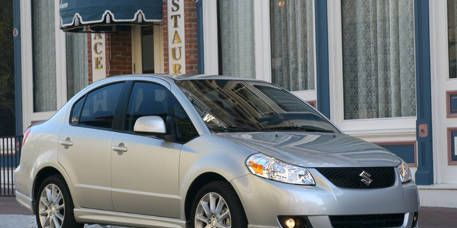 Tire, Wheel, Automotive mirror, Daytime, Vehicle, Glass, Automotive lighting, Headlamp, Rim, Car,
