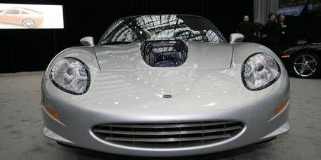 Motor vehicle, Mode of transport, Automotive design, Vehicle, Land vehicle, Headlamp, Car, White, Automotive lighting, Sports car,