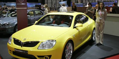 Motor vehicle, Mode of transport, Vehicle, Land vehicle, Yellow, Automotive design, Car, Transport, Vehicle registration plate, Hood,