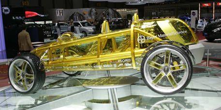 Mode of transport, Automotive design, Spoke, Rim, Auto part, Automotive wheel system, Exhibition, Classic, Auto show, Museum,