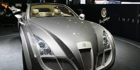Motor vehicle, Mode of transport, Automotive design, Vehicle, Land vehicle, Car, Grille, Automotive mirror, Personal luxury car, Headlamp,
