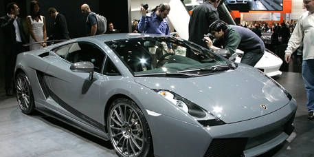Tire, Motor vehicle, Wheel, Mode of transport, Automotive design, Vehicle, Transport, Event, Automotive exterior, Rim,