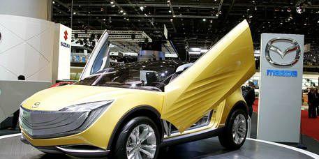 Motor vehicle, Automotive design, Vehicle, Yellow, Land vehicle, Car, Fender, Alloy wheel, Rim, Concept car,