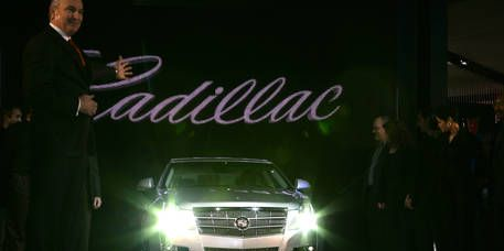 Vehicle, Land vehicle, Automotive design, Automotive lighting, Headlamp, Grille, Standing, Car, Formal wear, Full-size car,