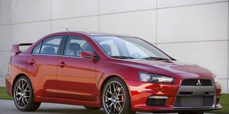 Tire, Wheel, Automotive design, Vehicle, Alloy wheel, Car, Rim, Automotive mirror, Red, Automotive lighting,