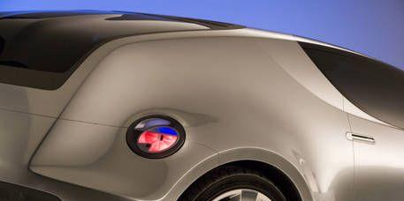 Automotive design, Automotive exterior, Alloy wheel, Automotive tire, Automotive lighting, Rim, Red, White, Automotive wheel system, Fender,