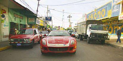 Motor vehicle, Mode of transport, Automotive design, Transport, Vehicle, Land vehicle, Automotive parking light, Road, Vehicle registration plate, Performance car,