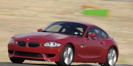 Tire, Automotive design, Mode of transport, Vehicle, Land vehicle, Hood, Car, Red, Performance car, Automotive tire,