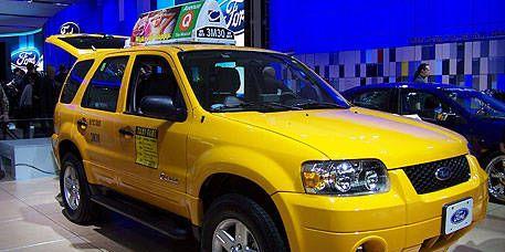 Tire, Motor vehicle, Wheel, Vehicle, Yellow, Land vehicle, Automotive design, Transport, Automotive tire, Car,