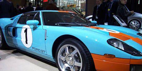 Tire, Vehicle, Automotive design, Land vehicle, Car, Performance car, Sports car, Fender, Automotive parking light, Hood,