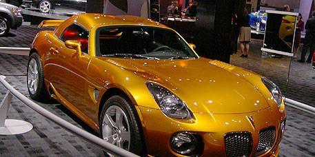 Tire, Wheel, Automotive design, Mode of transport, Land vehicle, Vehicle, Hood, Car, Performance car, Fender,