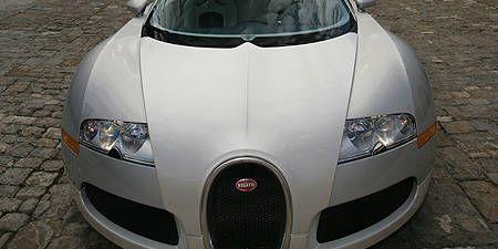 Mode of transport, Automotive design, Vehicle, Hood, Headlamp, Car, Grille, Photograph, White, Automotive mirror,