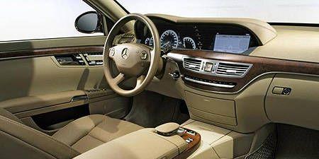 Motor vehicle, Steering part, Steering wheel, Brown, Product, Vehicle, Automotive mirror, Vehicle door, Center console, Car,