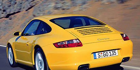 Vehicle, Yellow, Automotive design, Transport, Vehicle registration plate, Car, Landscape, Red, Automotive parking light, Performance car,