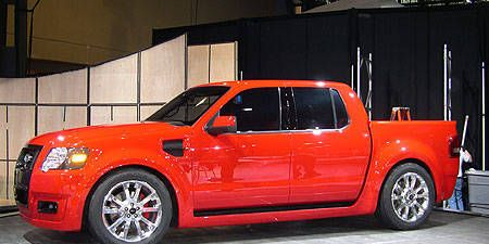 Tire, Motor vehicle, Wheel, Automotive design, Vehicle, Automotive tire, Rim, Red, Hood, Automotive parking light,